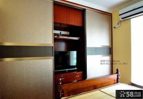 卧室衣柜电视柜一体效果图