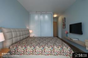 现代卧室衣柜电视背景墙效果图
