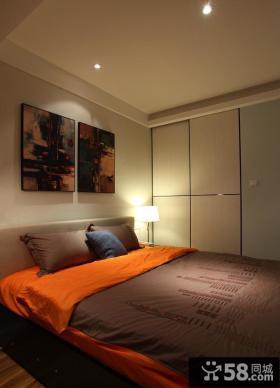 现代小户型卧室床头挂画效果图